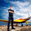 Man on the top of mountain and airplane — Stock Photo #6357640