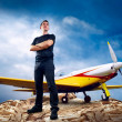 Man on the top of mountain and airplane — Stock Photo