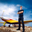 Man on the top of mountain and airplane — Stock Photo #6357643