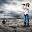 Young boy watch in the field-glass under sky — Stock fotografie