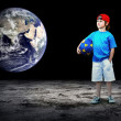 Child football player and Grunge ball on the dark background — ストック写真