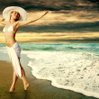 Young beautiful women in the white on the sunny tropical beach — Stock Photo