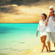 View of happy young family having fun on the beach — Stock Photo #6357795