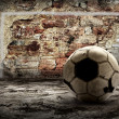 Grunge ball on the retro grunge background - Stock Photo