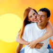 Young love couple smiling under blue sky — Stock fotografie