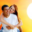 Young love couple smiling under blue sky — Stock Photo #6357932
