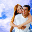 Young love couple smiling under blue sky — Stock Photo #6357937