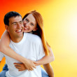 Young love couple smiling under blue sky — Stok Fotoğraf #6357938