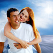 Young love couple smiling under blue sky — Stock Photo #6357948