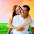 Young love couple smiling under blue sky — Stock Photo #6357949