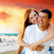 Stock Photo: Young love couple smiling under tropical beach