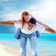 Beautiful couple on the sunny tropical beach — Stock Photo