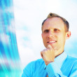Happiness businessman on blur business architecture background - Foto de Stock