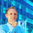 Happiness businessman on blur business architecture background - Stock fotografie