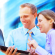 Happiness businessmans withlaptop on blur business architecture — Stock Photo