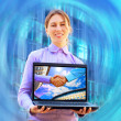 Happiness business woman with laptop on blured background - Stock Photo