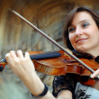 Playing violinist on the grunge background - Stockfoto