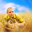 Royalty-Free Stock Photo: Happy man on the golden wheat field and blue sky