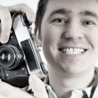 Happiness man with vintage photo camera. — Photo