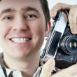 Happiness man with vintage photo camera. - Stock Photo