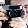Stock Photo: Happiness man with vintage photo camera.