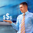 Happy businessman with dollar sign in his hand — Stock Photo