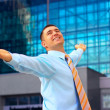 Hapy Businessman standing on the business background — Stock Photo #6358487