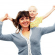 Son on his mother's shoulders having fun — Stock Photo