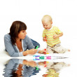 Happiness child with parents paint - Stockfoto