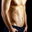 Naked muscular male model in jeans - Stock Photo