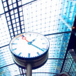 Clock in railway station - Stock Photo