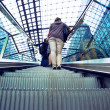 Passangers with bag on railway station escalator - Stock fotografie