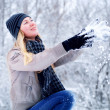 Foto de Stock  : Young happy smiling blond girl outdoor in winter