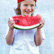 Child with part of watermelon, isolated on the white background — Photo