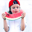 Child with part of watermelon, isolated on the white background — Lizenzfreies Foto