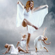 Woman dancer seating posing on background — Stock Photo #6358927