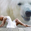 Woman dancer seating posing on wild annimals background — Stock Photo
