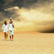 Happiness family fun in desert in sunny day — Stock Photo #6359042