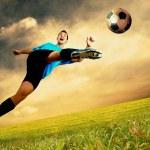 Happiness football player on field of olimpic stadium on sunrise — Stock Photo #6359047