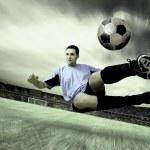 Happiness football player on field of olimpic stadium on sunrise — Stock Photo #6359056