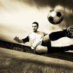 Happiness football player on field of olimpic stadium on sunrise — Stock Photo #6359059