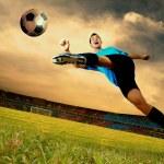 Happiness football player on field of olimpic stadium on sunrise — Stock Photo #6359063