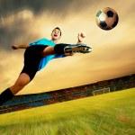 Happiness football player on field of olimpic stadium on sunrise — Stock Photo #6359064