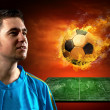 Football player and fire ball on the field — Stock Photo #6359090