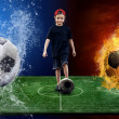 Child and ball on the soccer field with fires and waters balls — Lizenzfreies Foto