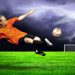 Shoot of football player on the outdoors field - Stockfoto