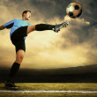 Shoot of football player on the outdoor field - Stok fotoğraf
