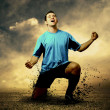 Shoot of football player on the outdoor field - Stockfoto