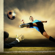 Shoot of football player and goalkeeper - Stok fotoğraf