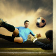 Shoot of football player and goalkeeper - Stockfoto